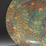 Falling Leaves . Available in 8 and 12 inch plates or 10 inch bowl. Shown with Sage background, also available with olive or black background.