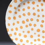 Tiny Dots White. Available in 8 and 12 inch plates or 10 inch bowl.